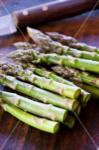 Fresh green asparagus on a wooden table