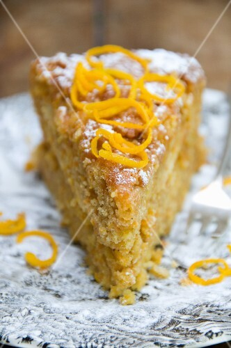 A slice of carrot cake with carrot zest