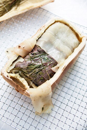 Saddle of venison in a salt dough with pine needles