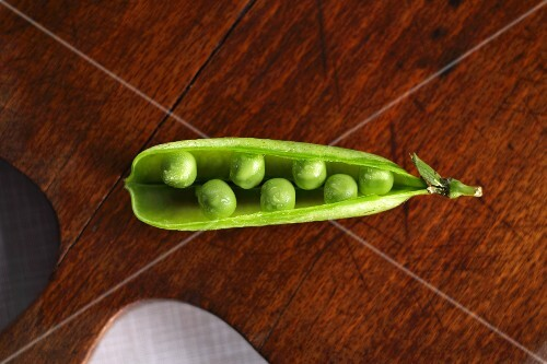 An open pea pod viewed from above