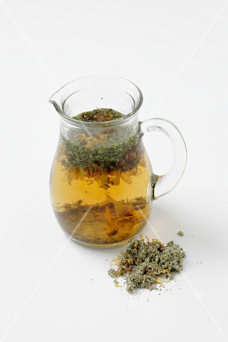 Coltsfoot infusion in a glass jug