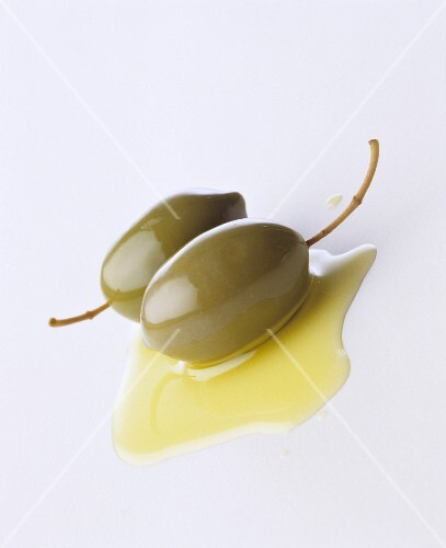 Olives in a small pool of olive oil