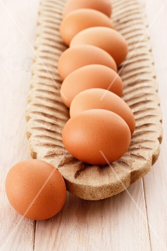 Brown eggs in a wooden dish