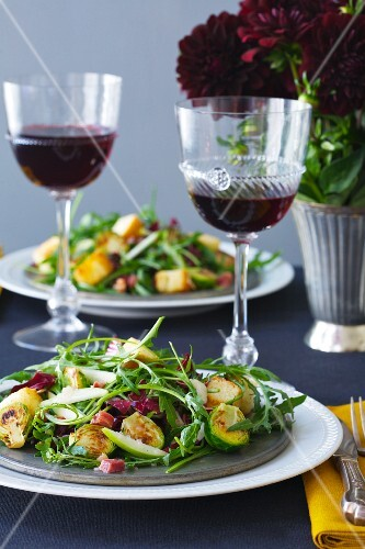 Brussel Sprout and Arugula Salad and glasses of Red Wine