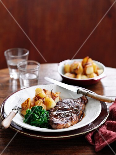 Beef steak with spinach and potatoes