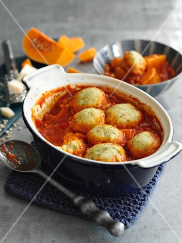 Squash stew with tomatoes, barley and pesto dumplings