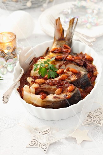 Baked carp with almonds, raisins and gingerbread sauce, for Christmas