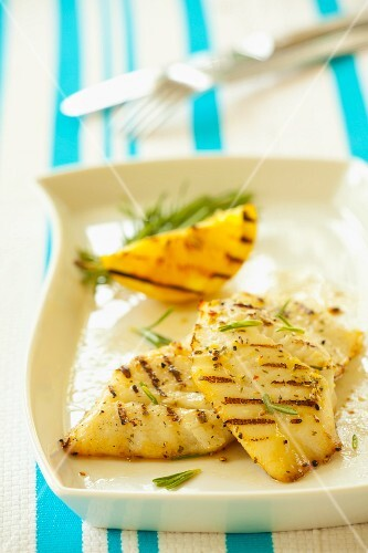 Grilled halibut fillets with rosemary and lemon