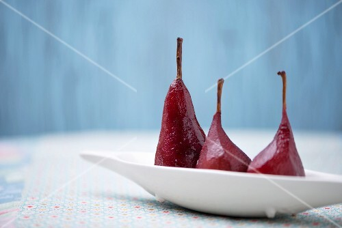 Three red wine poached pears