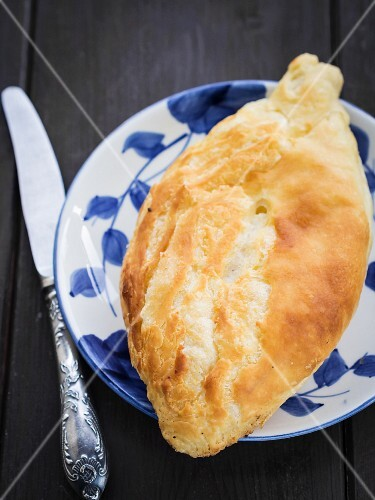 Traditional Georgian cheese bread (khachapuri) called nahevrad penovani.