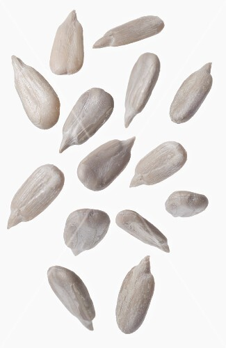Sunflower seeds in front of white background