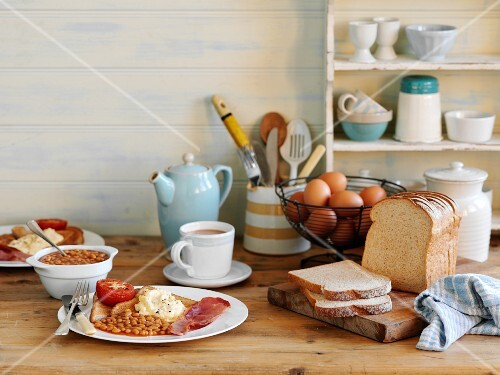 English breakfast with baked beans, fried egg, bacon and toast