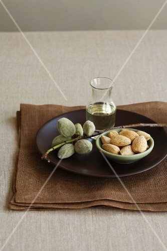 Fresh Almonds on Branch, Almond Oil and Almond in Shells