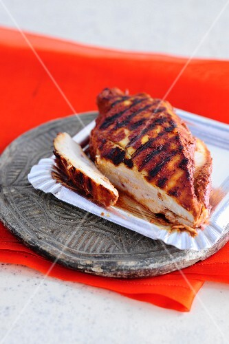 Tandoori chicken breast cooked on the barbecue