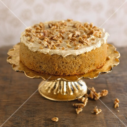Walnut cake on a golden cake stand