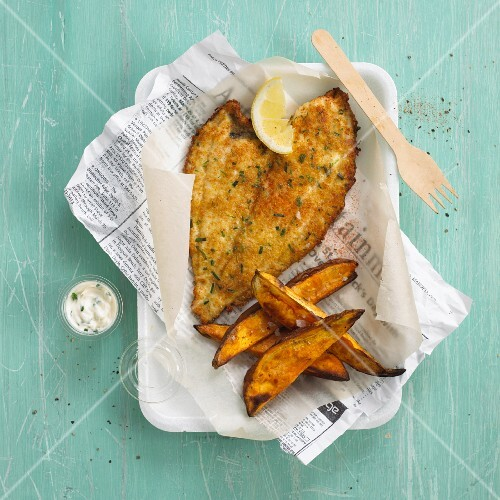 Fish and chips on newspaper