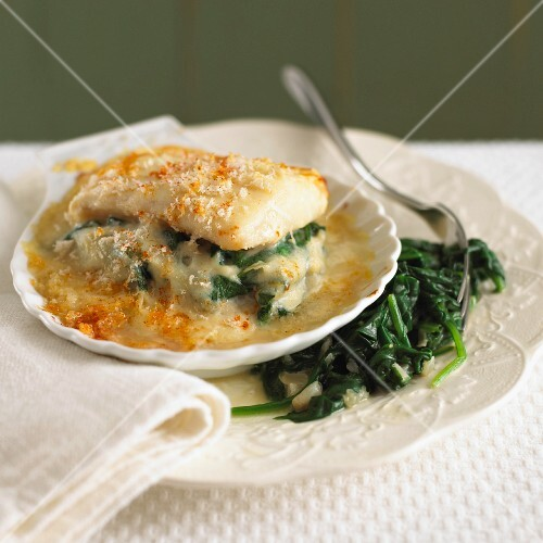 Haddock baked with cheese, served with spinach