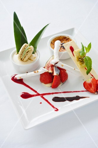 A dessert plate with strawberries, cr