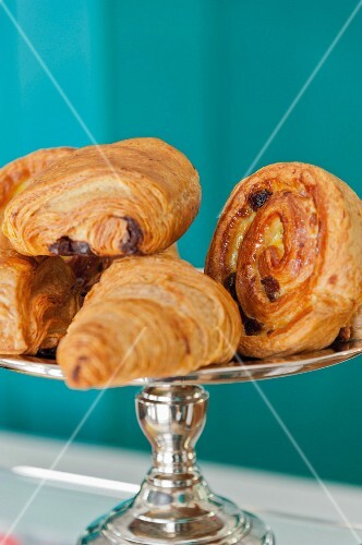 Sweet Danish pastries on a silver cake stand