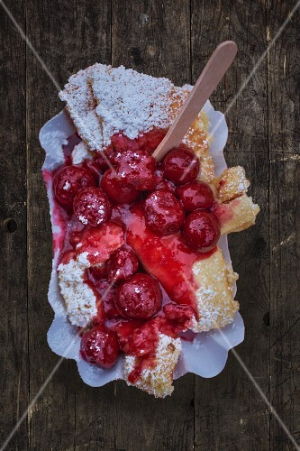 Kaiserschmarren (shredded sugared pancake from Austria) with warm cherries