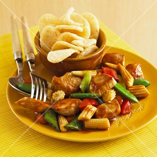 Sweet and sour chicken with baby sweetcorn and prawn crackers