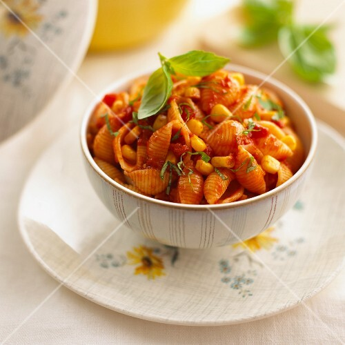 Pasta shells with tomato sauce, sweetcorn and basil