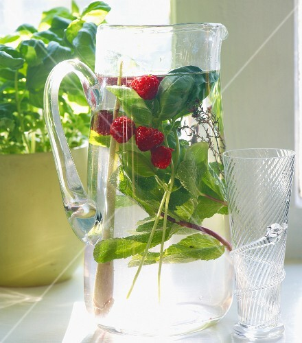 Herb-infused water with raspberries