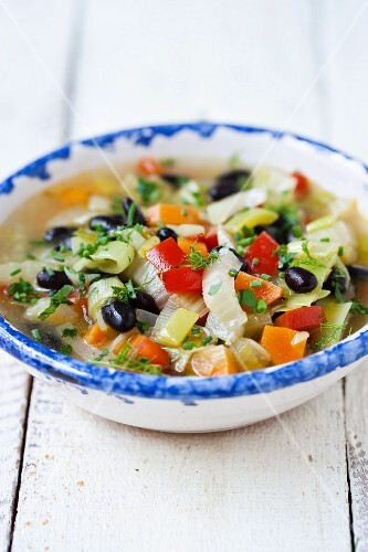 Vegetable soup with olives and thyme