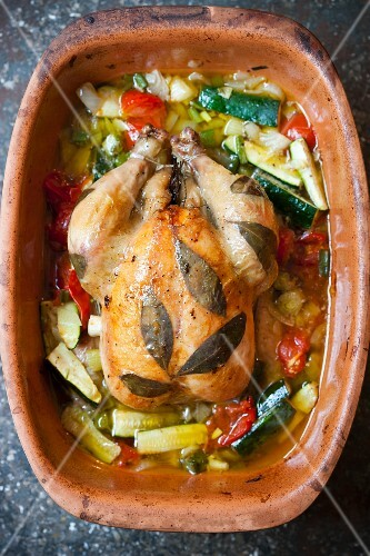 Bay chicken with vegetables in a clay pot