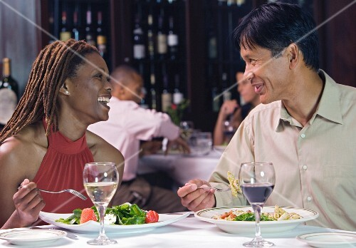 Couple enjoying healthy meal in restaurant