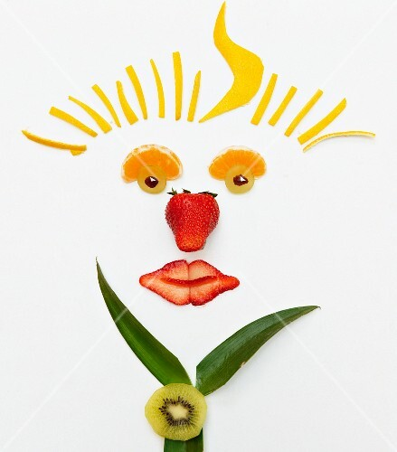 A smiling face made from fruit