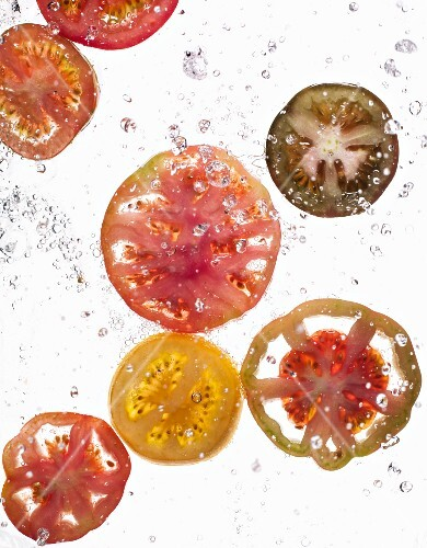 Slices of tomato in water