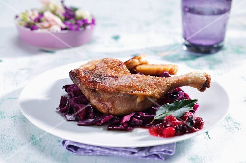 Duck leg on red cabbage
