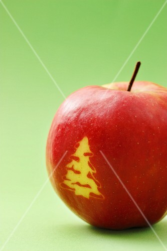 Red apple with a Christmas tree