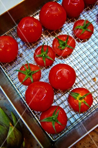 Washed tomatoes on a draining rack