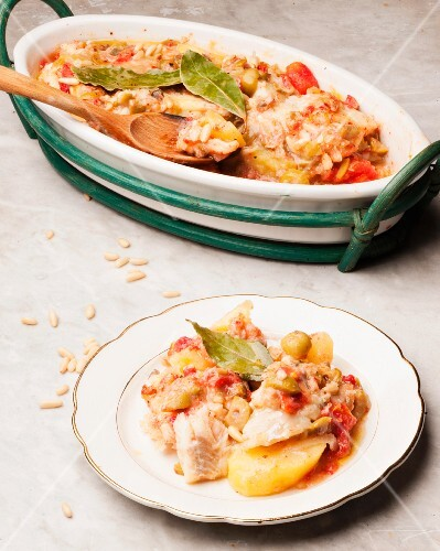 Salt cod alla messinese with potatoes, tomatoes and olives (Sicily)