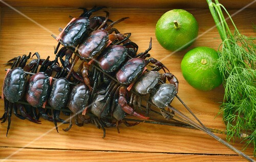 Crayfish skewers, limes and dill (Thailand)