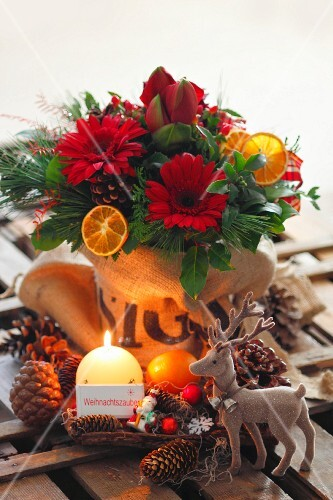 Christmas bouquet, reindeer, pine cones and candles