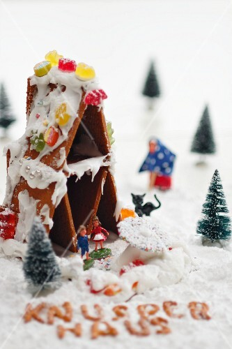 A gingerbread house with fairy-tale figures