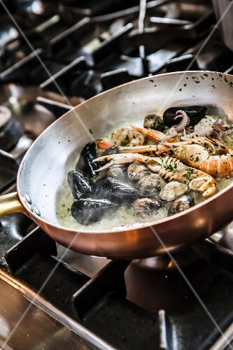 Seafood cooking in white wine