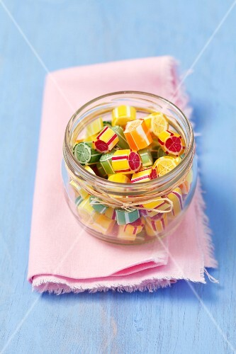 Colourful fruit sweets in a jar