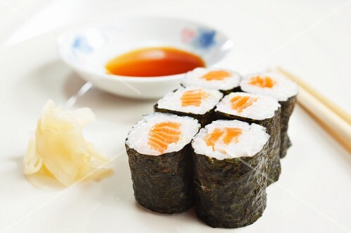Maki sushi with salmon, ginger and soy sauce