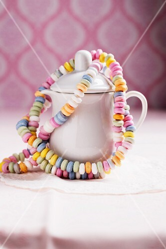 Colourful candy bracelets hanging on a milk jug