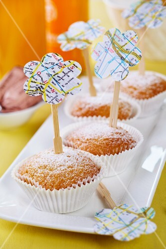 Lemon muffins with wooden skewers decorated with flower shapes punched out of map