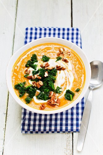 Sweet potato soup with green cabbage and pecan nuts