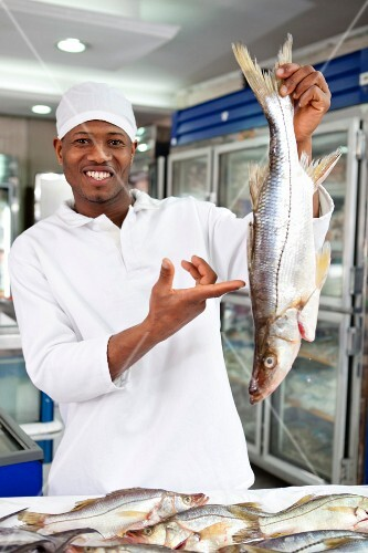 A fish monger with fresh fish