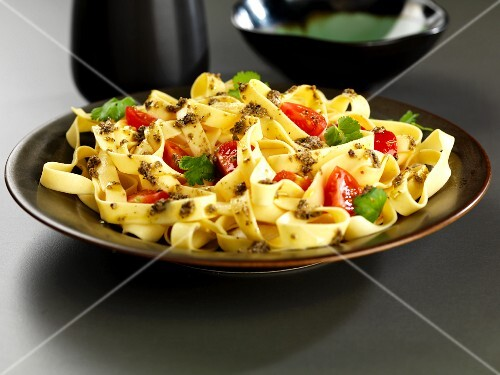 tagliatelle with coriander and chili pasta sauce and tomatoes
