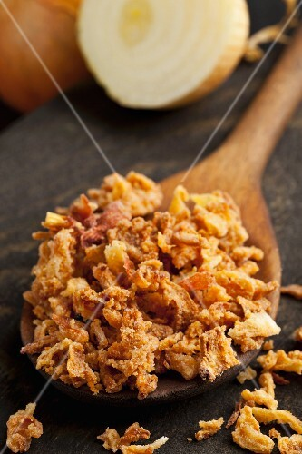 Crispy fried onions on a wooden spoon
