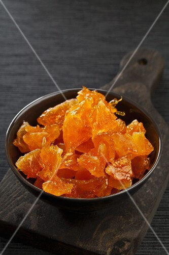 A bowl of candied orange pieces