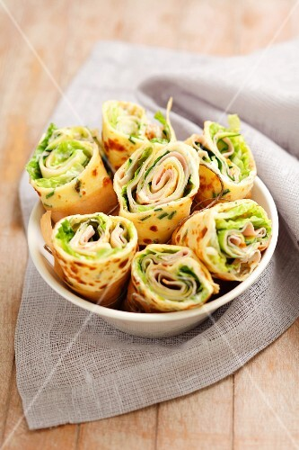 Pancake wraps with mayonnaise, salad and ham
